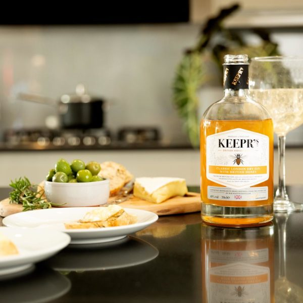 Keepr's Classic London Dry with British Honey - bottle with glass and cheese biscuits