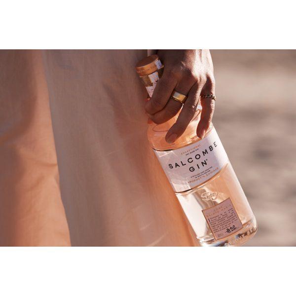 Salcombe - Rose Sainte Marie Gin - hand holding bottle