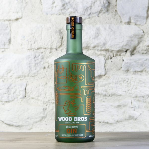 Wood Bros - Single Estate Gin bottle against wall